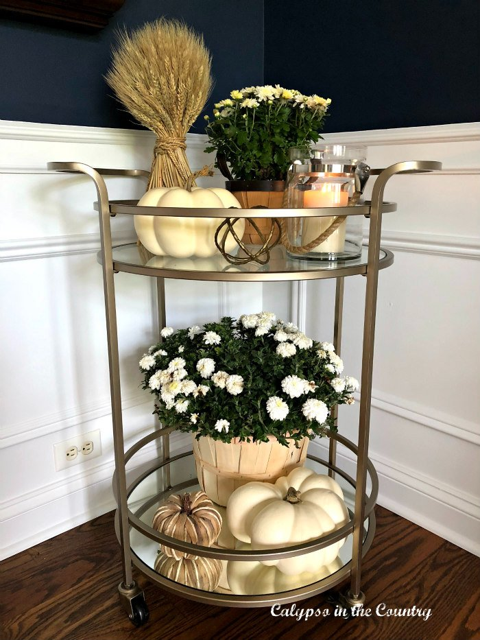 mums and white pumpkins on fall bar cart - how to decorate with pumpkins